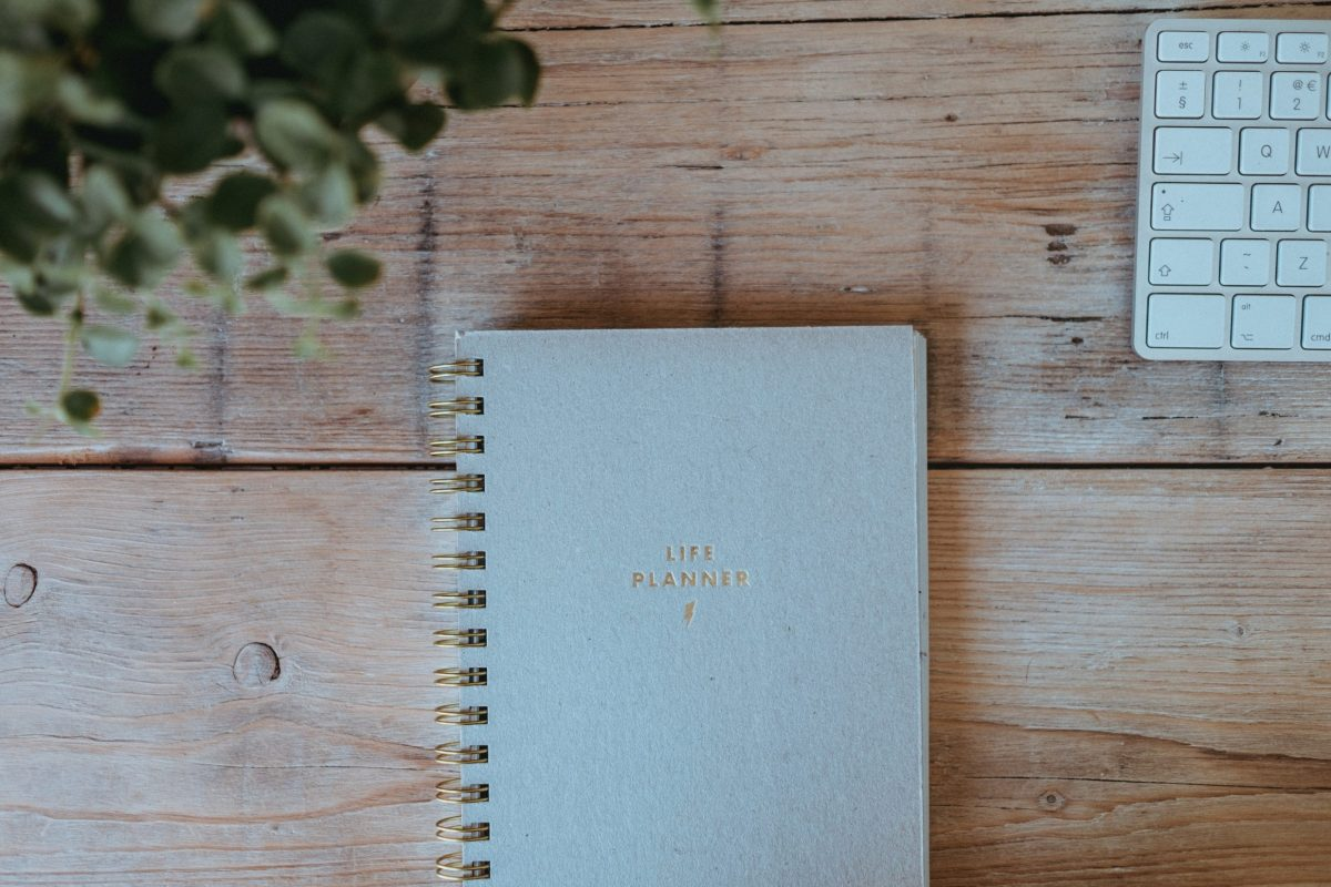 A life planner near a white keyboard